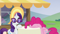 Pinkie Pie presses her face on the table S6E21.png