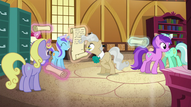 File:Mayor Mare signing a scroll S6E4.png