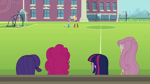File:Applejack and Rainbow Dash arguing in background EG.png