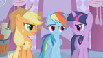 Applejack and Twilight look at Rainbow Dash in disapproval S1E14