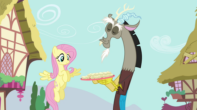 File:Discord showing Fluttershy a plate of cucumber sandwiches S4E26.png