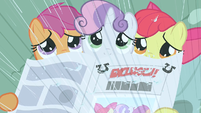 CMC sad with newspaper S2E23