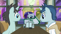 Rarity holding up an arrow sign S6E12