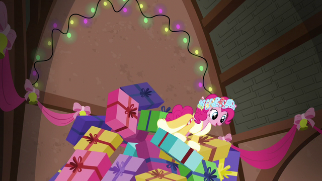 File:Spirit of HW Presents surfing the collapsing gift pile S6E8.png