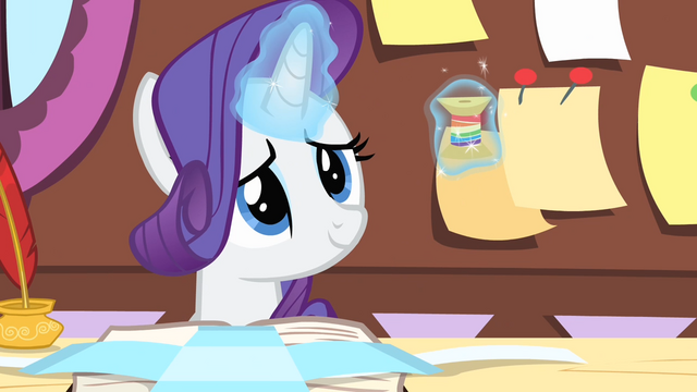 File:Rarity smiling while levitating the thread S4E08.png
