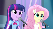 Twilight and Fluttershy start singing Shake Your Tail EG2