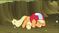 Applejack drops down to the ground for cover from debris created by Rainbow Dash S2E03