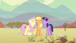 Fluttershy and Twilight nuzzling Applejack S2E14