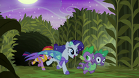 Rarity and Spike run out of the cave S5E21