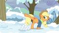 Applejack kicks a snowball at Pinkie Pie S5E5.png