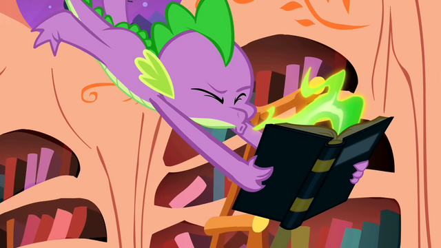 File:Spike sneezes fire on the book S1E24.png