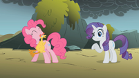 Pinkie Pie swings a rubber chicken S1E07