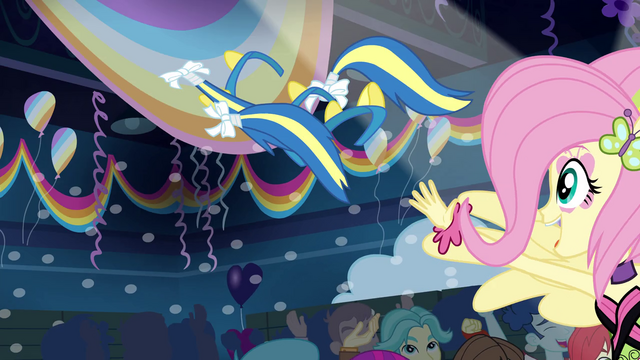 File:Fluttershy distributes pony ears and tails EG2.png