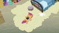 Scootaloo lying on Rainbow Dash's old carpet S7E7