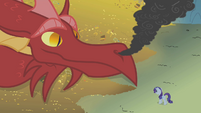 Dragon looking at Rarity S1E07