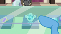 Trixie pointing at brooch in display case S7E2