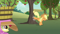 Applejack bucking another apple tree S7E9.png