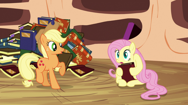 File:Fluttershy holds a book with her hooves S3E05.png