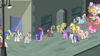 Main cast walking beside a line of ponies S4E08