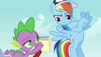 Rainbow Dash looking at notebook S2E22