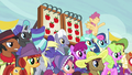 Ponyville spectators cheer; Appleloosa spectators sad S6E18.png