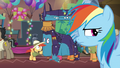Rainbow passes by ponies in Ahuizotl costume S6E13.png