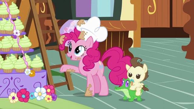 File:Pinkie points at the mountain of cupcakes S5E19.png