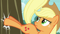 Applejack bucking a third apple tree S7E9.png