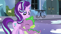 Starlight looking at Spike hugging her S6E2