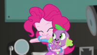 Pinkie stuffs the cupcake into her mouth EGS2