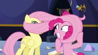 Pinkie wraps Fluttershy's mane around her head S5E11
