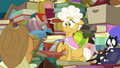 Goldie Delicious sits on one of her cats' tail S7E13.png