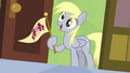 Derpy holding Ponyville flag S04E10.png