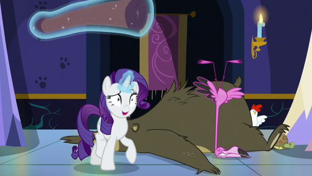 File:Rarity walks away with rolled-up carpet S6E21.png