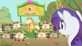 Applejack at her Fluttershy apple stand S01E20.png