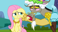 Discord grabbing Fluttershy's cheek S3E10