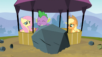 Spike holds a rock S3E09