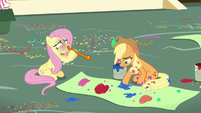 Applejack paints a banner and Fluttershy blows a balloon S5E11