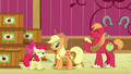 Applejack scrunches her face as Big Mac laughs S6E23.png