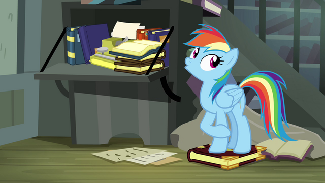 File:Rainbow Dash standing on book S4E04.png