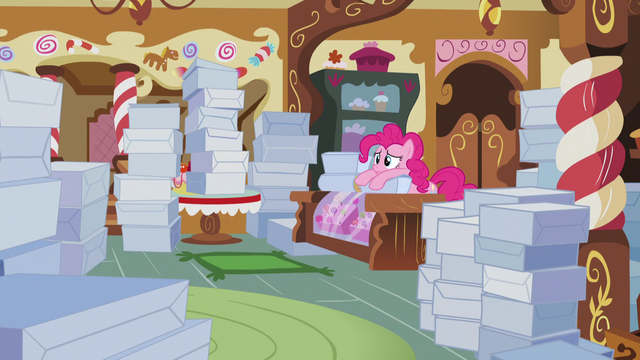 File:Pinkie sad and surrounded by cake boxes S5E7.png