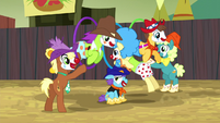 Rodeo clowns jumping through hoops S5E6