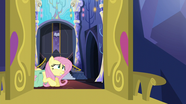 File:Fluttershy struggling under her bags S5E23.png