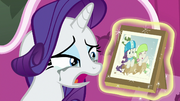 Rarity tearfully looks at sledding photo S7E6.png