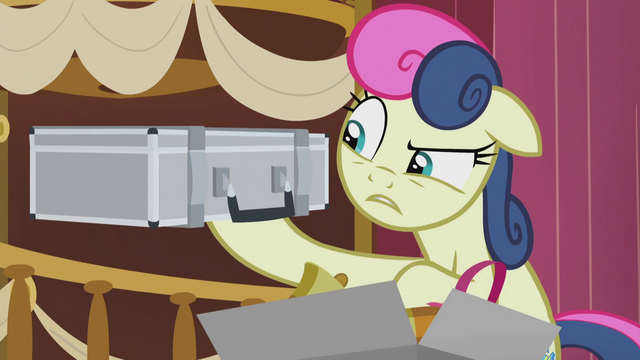 File:Sweetie Drops holding up a disguise case S5E9.png