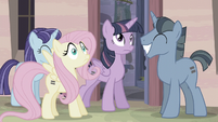 Twilight hits her hoof onto Fluttershy's leg S5E02