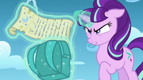 Starlight opens a scroll S5E26