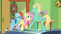 Fluttershy and Rainbow drive Zephyr back inside the room S6E11.png