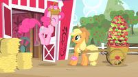 Applejack looks at Pinkie jumping S1E25