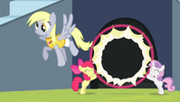 Derpy flying through the hoop S4E24